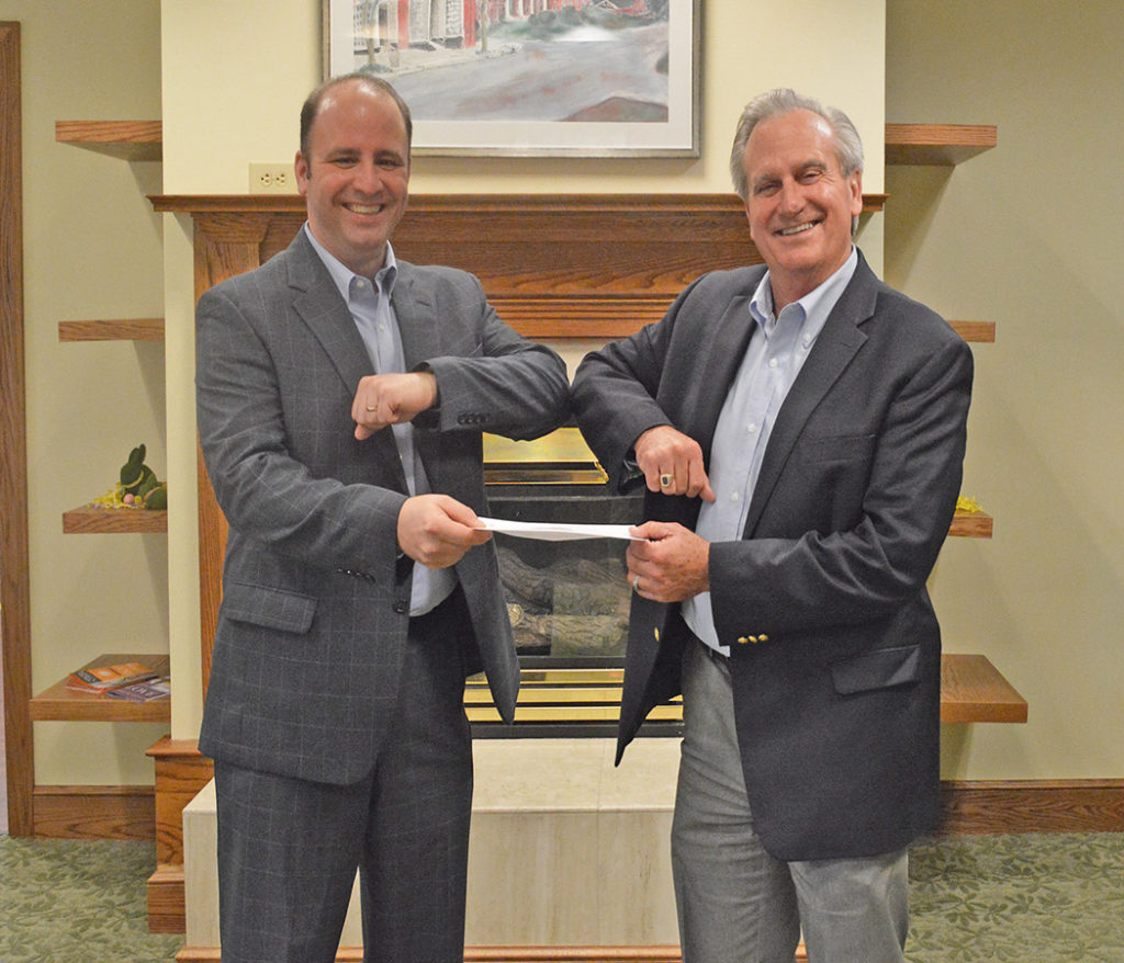 Moravian Ministries Foundation in America president and CEO Chris Spaugh receives funding from Salemtowne president and CEO Mark Steele